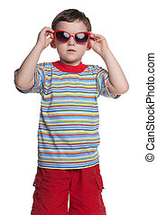 Serious little boy with sunglasses