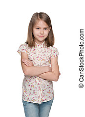 Serious little girl against the white background