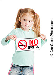Serious Little Girl With No Smoking Sign. - Unhappy little...