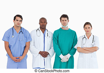 Serious looking medical team standing together