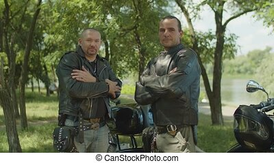 Serious male riders greeting in bikers style - Serious...