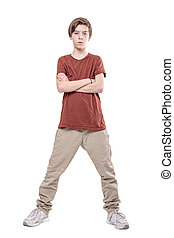serious male teenager standing with crossed arms, isolated on white.