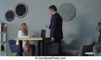 Serious man at job application interview in office