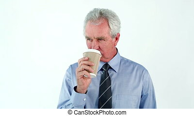 Serious man drinking a coffee against a white background