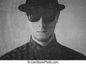 Serious man in a hat - Portrait of serious man in sunglasses...