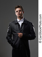 serious man in a leather coat