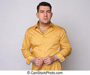 serious man look with suspicion at camera