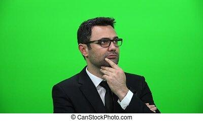 Serious Man Looking Sideways on Green Screen Background