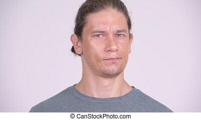 Serious man nodding head no against white background -...