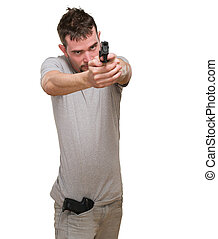 serious man pointing with gun