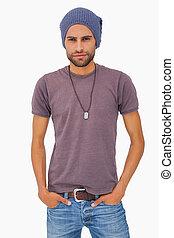 Serious man wearing beanie hat