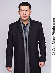 Serious man wearing coat. isolated