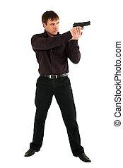 serious man with a gun standing against isolated white...