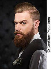 Serious man with beard and severe look
