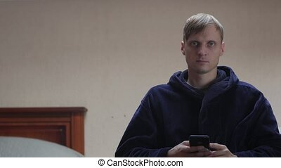 Serious Man With Phone Looking At Camera