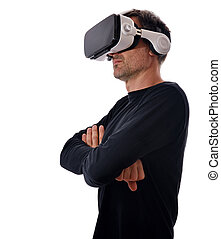 Serious man in black sweater with virtual reality glasses and arms crossed in lateral position. Vertical composition. Isolated white