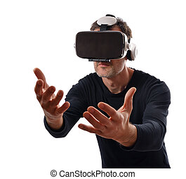 Serious man wearing black pullover and virtual reality glasses interacting with his hands in front. Isolated white