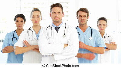 Serious medical team with arms cro