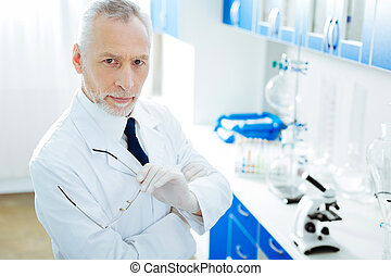Serious medical worker posing in the laboratory