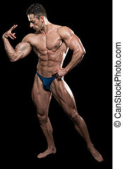 Serious Men Standing And Flexing Muscles - Young Bodybuilder...