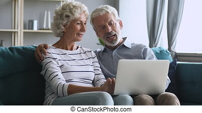 Serious middle aged man explaining new computer software to ...