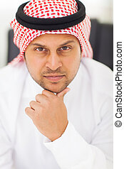 serious middle eastern businessman - close up portrait of...