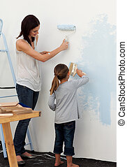 Mother and her daughter painting