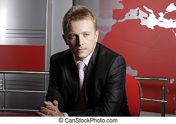 Serious news reporter in studio - Serious reporter in...