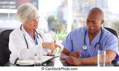 Serious nurse and doctor working together