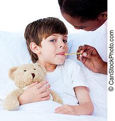 Serious nurse taking child's temperature