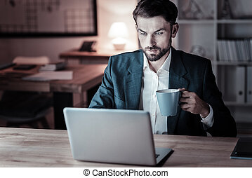 Serious office worker going to drink tea