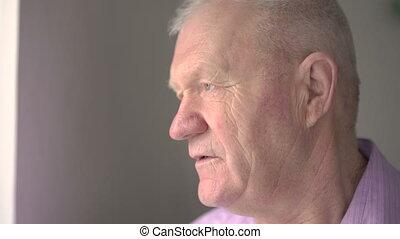 Serious older man look at the camera 4k