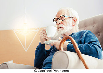 Serious pensioner having morning relax