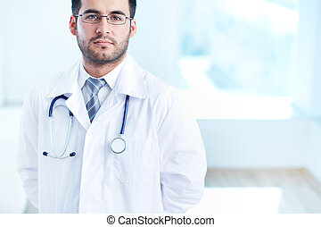 Serious physician - Portrait of serious doctor with ...