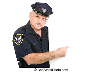 Serious Policeman Pointing - Serious, mature police officer ...
