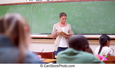 Serious pupils listening to their teacher