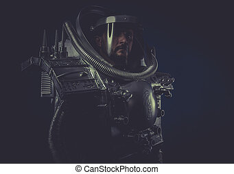 Serious, robot man in space armor silver