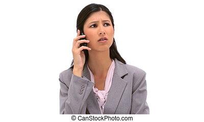 Serious secretary talking on the phone