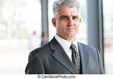 serious senior businessman close up portrait