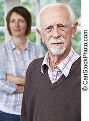Serious Senior Man With Adult Daughter At Home