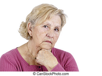 Portrait of a serious senior woman holding her chin looking at the camera, isolated on white.