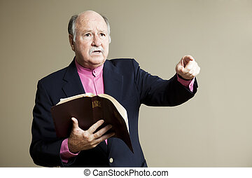 Serious Sermon - Minister delivering a serious sermon in...