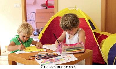siblings sketching with pencils