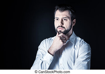 Serious smart man focusing on his thoughts