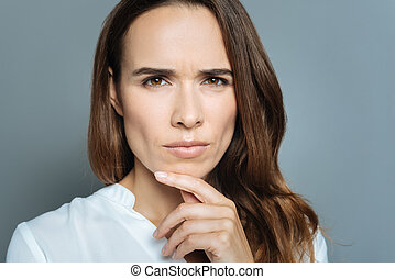 Serious smart woman looking at you