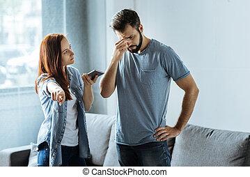 Serious smart woman sending away her boyfriend