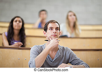 Serious students listening during a lecture with the camera...