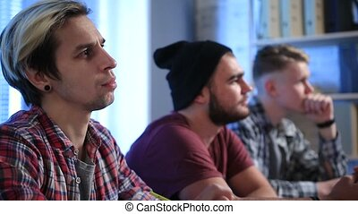Serious students listening teacher during lecture