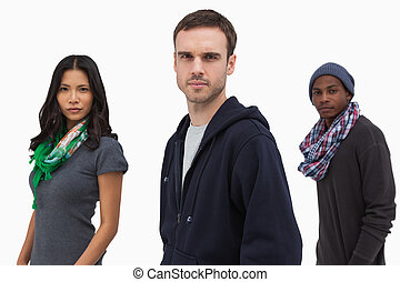 Serious stylish young people in a line on white background