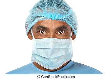 A surgeon with penetrating eyes is ready to start working.